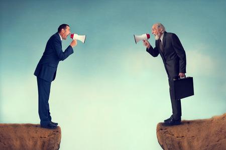 Photo pour businessmen shouting through megaphones business conflict concept - image libre de droit