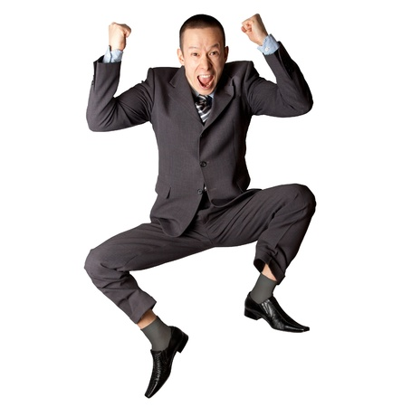 Happy businessman jumping in air isolated on white background