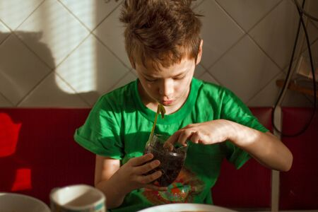 Foto de Boy with chickenpox grow plant from the seed. Chickenpox rash. Sprouted seed - Imagen libre de derechos