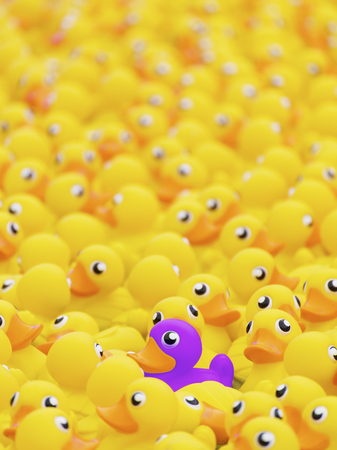 Photo pour Unique purple toy duck among many yellow ones. Standing out from crowd, individuality and difference concept - image libre de droit