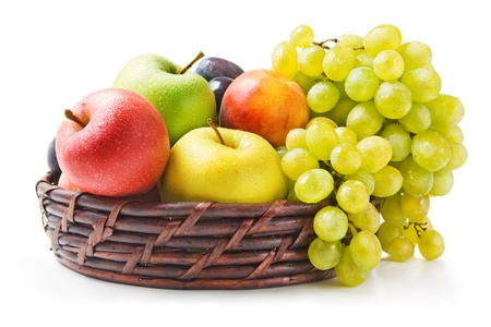 Photo pour Fruits. Various fresh ripe fruits arranged in a wicker basket isolated on white background - image libre de droit