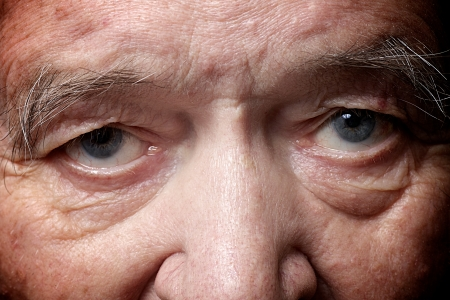 Photo for old man face part closeup eyes looks at camera - Royalty Free Image