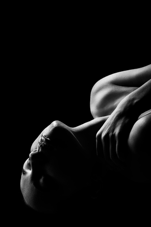 Foto de sensual aroused woman with bare shoulders, closed eyes on black background, monochrome - Imagen libre de derechos