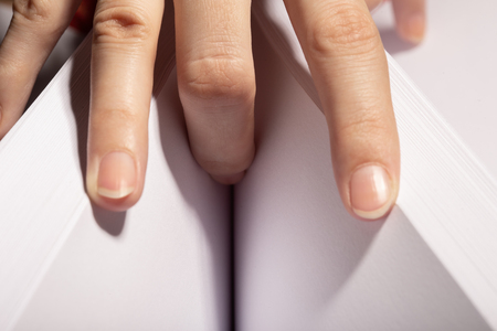 Photo pour female hand on paper cleavage, illusion covering female pussy, finger in crotch - image libre de droit