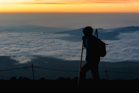 Hikers gather during sunrise on the Mt. Fuji .