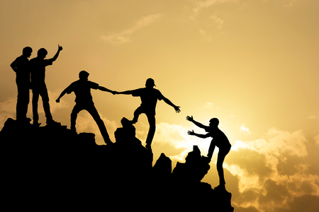 Photo pour Group of people on peak mountain  climbing helping team work , success concept - image libre de droit