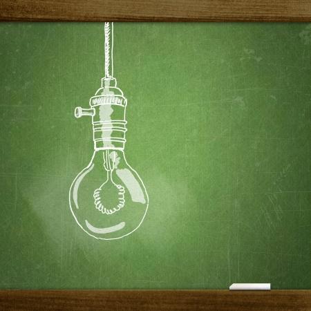 Foto de school sketches on blackboard, lamp - Imagen libre de derechos