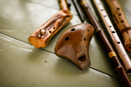 Photo for Different folk flutes from wood and steel - Royalty Free Image