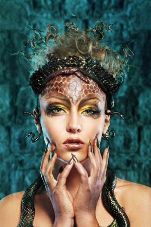 Photo for Gorgon medusa in dungeon. Young woman with creative fantasy hairstyle and make up - Royalty Free Image