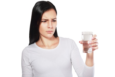 Photo for dangerous water young asian woman looking at water looking unhappy or disgusted - Royalty Free Image
