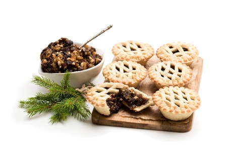 Photo pour Mince  pie group on cutting board isolated on white - image libre de droit