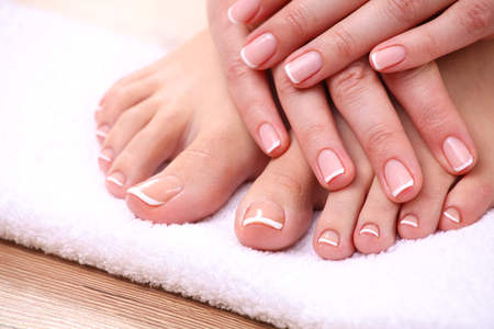 Photo pour Closeup photo of a beautiful female feet with red pedicure isolated on white. - image libre de droit
