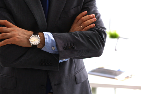 Photo for suited man with arms crossed in front. - Royalty Free Image