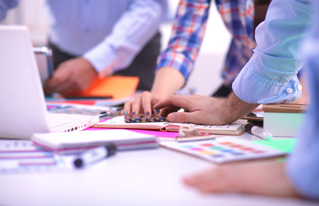 Photo for Close-up of three young creative designers working on project together. Team work. - Royalty Free Image