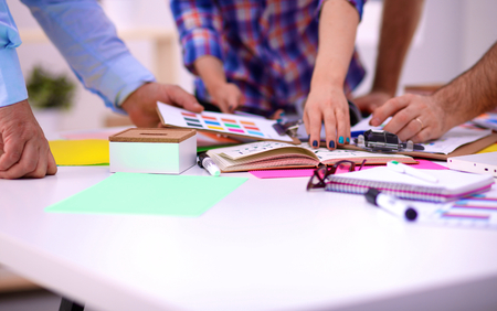 Photo for Young business people working at office on new project. - Royalty Free Image