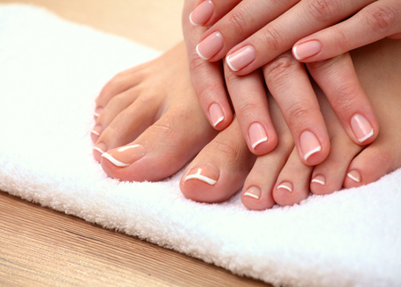 Foto de Closeup photo of a beautiful female feet with pedicure. - Imagen libre de derechos