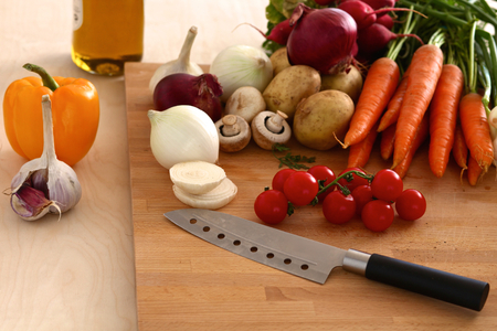 Composition with assorted raw organic vegetables wooden table.