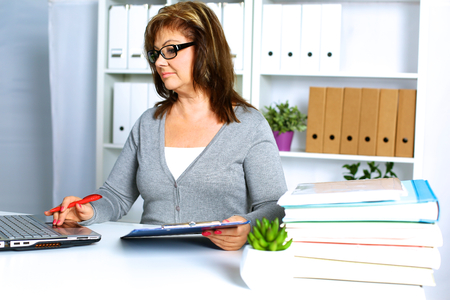 Photo for the woman behind the desk in the Office - Royalty Free Image