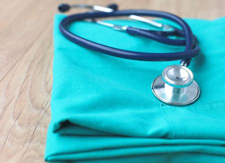 Photo pour A stethoscope shaping a heart on a medical uniform, closeup, selective focus - image libre de droit