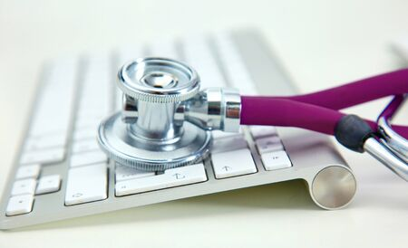 Photo pour Stethoscope lying on a table on an open book. - image libre de droit
