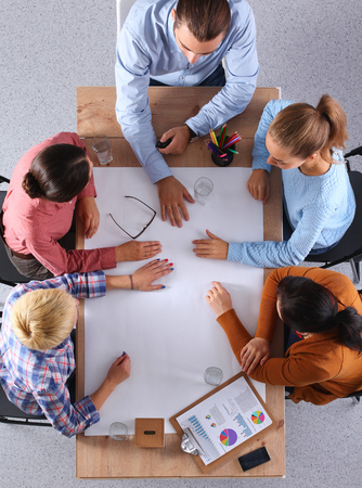 Foto de Business people sitting and discussing at business meeting, in office - Imagen libre de derechos