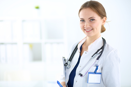 Photo for Woman doctor standing with folder at hospital - Royalty Free Image