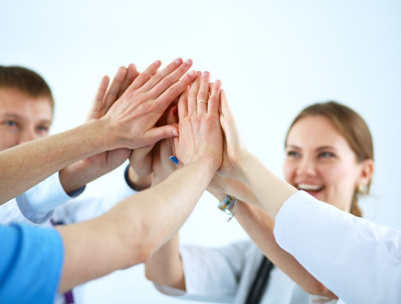 Photo for Doctors and nurses in a medical team stacking hands  . - Royalty Free Image