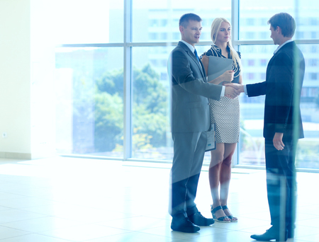 Business people shaking hands after meeting .
