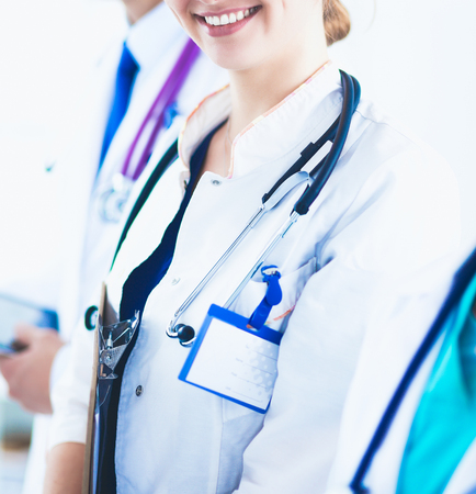Foto de Attractive female doctor in front of medical group - Imagen libre de derechos