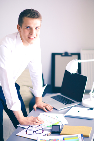 Photo for Young business man working in office ,standing . Young business man - Royalty Free Image
