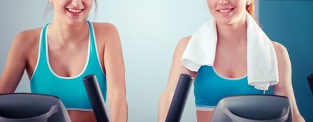 Foto per Group of people at the gym exercising on cross trainers. people at the gym - Immagine Royalty Free
