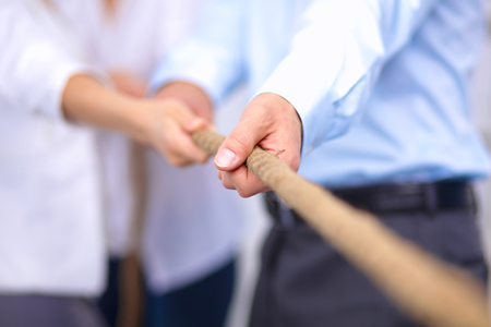 Photo for Concept image of business team using a rope as an element of the teamwork - Royalty Free Image