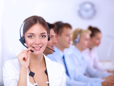 Foto de Attractive  positive young businesspeople and colleagues in a call center office - Imagen libre de derechos