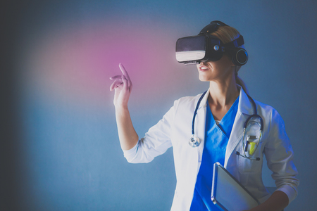 Photo pour Female doctor wearing virtual reality glasses isolated on white background - image libre de droit