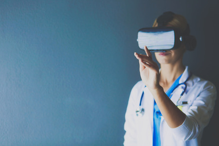Foto de Female doctor wearing virtual reality glasses isolated on white background - Imagen libre de derechos
