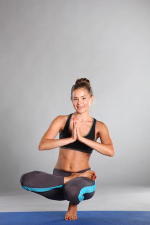 Photo for Portrait of sport girl doing yoga stretching exercise . yoga - Royalty Free Image