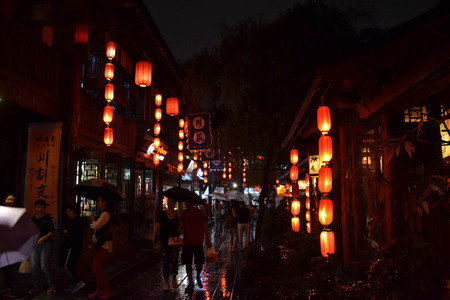 Photo for Tourists visiting shops and stores around the scenic Jinli Ancient Street of Chengdu. Pic was taken in September 2017 - Royalty Free Image