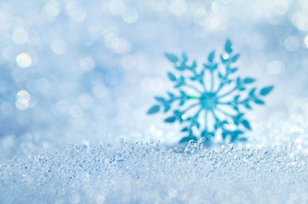 Foto de Christmas background with icy blurred decorative snowflake - Imagen libre de derechos