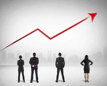 Photo pour Business team watching sales grow up on the background - image libre de droit