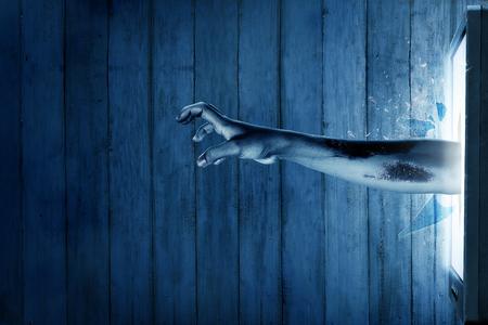Photo pour Zombie hand come out from television. Halloween concept - image libre de droit