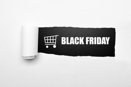 Foto de Shopping cart and black friday text on paper tear. Black friday concept - Imagen libre de derechos