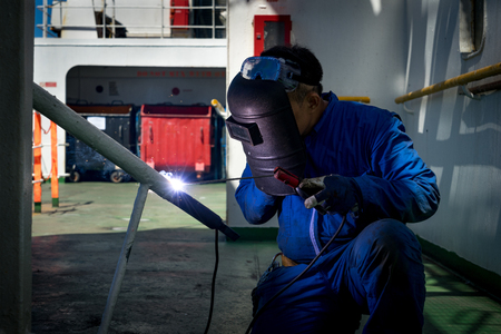 Photo for worker during welding on board a ship - Royalty Free Image