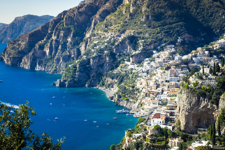 Photo for Best resorts of Italy with old colorful villas on the steep slope, numerous yachts and boats in harbor along the coast, Positano. - Royalty Free Image