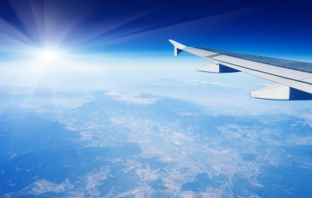 Photo for Wing of airplane flying above the clouds in the sky - Royalty Free Image