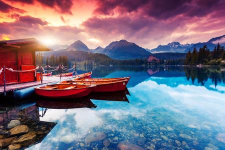 Photo for Peaceful mountain lake in National Park High Tatra. Dramatic overcast sky. Strbske pleso, Slovakia, Europe. Beauty world. - Royalty Free Image