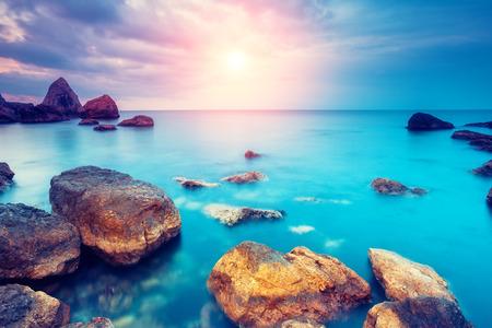 Foto de Fantastic morning blue sea glowing by sunlight. Dramatic scene. Black Sea, Crimea, Ukraine, Europe. Beauty world. Retro style filter.  - Imagen libre de derechos