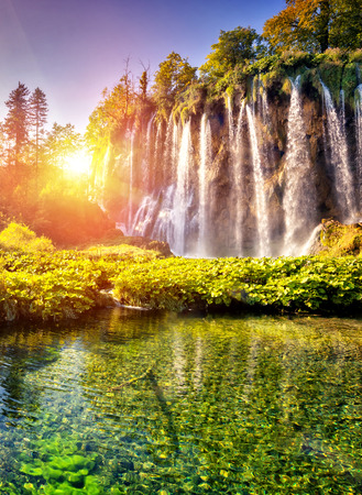 Photo for Majestic view on waterfall with turquoise water and sunny beams in Plitvice Lakes National Park in Croatia. - Royalty Free Image