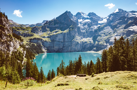Photo for Panorama of the azure pond Oeschinensee. Popular tourist attraction. Picturesque and gorgeous scene. Location Swiss alps, Kandersteg, Bernese Oberland, Europe. - Royalty Free Image