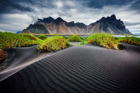 Foto de Great wind rippled beach black sand. Picturesque and gorgeous scene. Popular tourist attraction. Location famous place Stokksnes cape, Vestrahorn (Batman Mountain), Iceland - Imagen libre de derechos