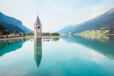 Photo for The old bell tower of Curon Venosta church rising out of the waters lake of Resia, Graun im Vinschgau village, Trentino-Alto Adige region of Italy, Europe. Gorgeous scene. Explore the world's beauty. - Royalty Free Image